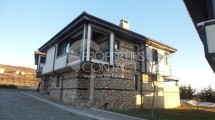We offer for sale two-storey furnished house with  yard in a gated-type complex in  Kosharitsa, Bulgaria